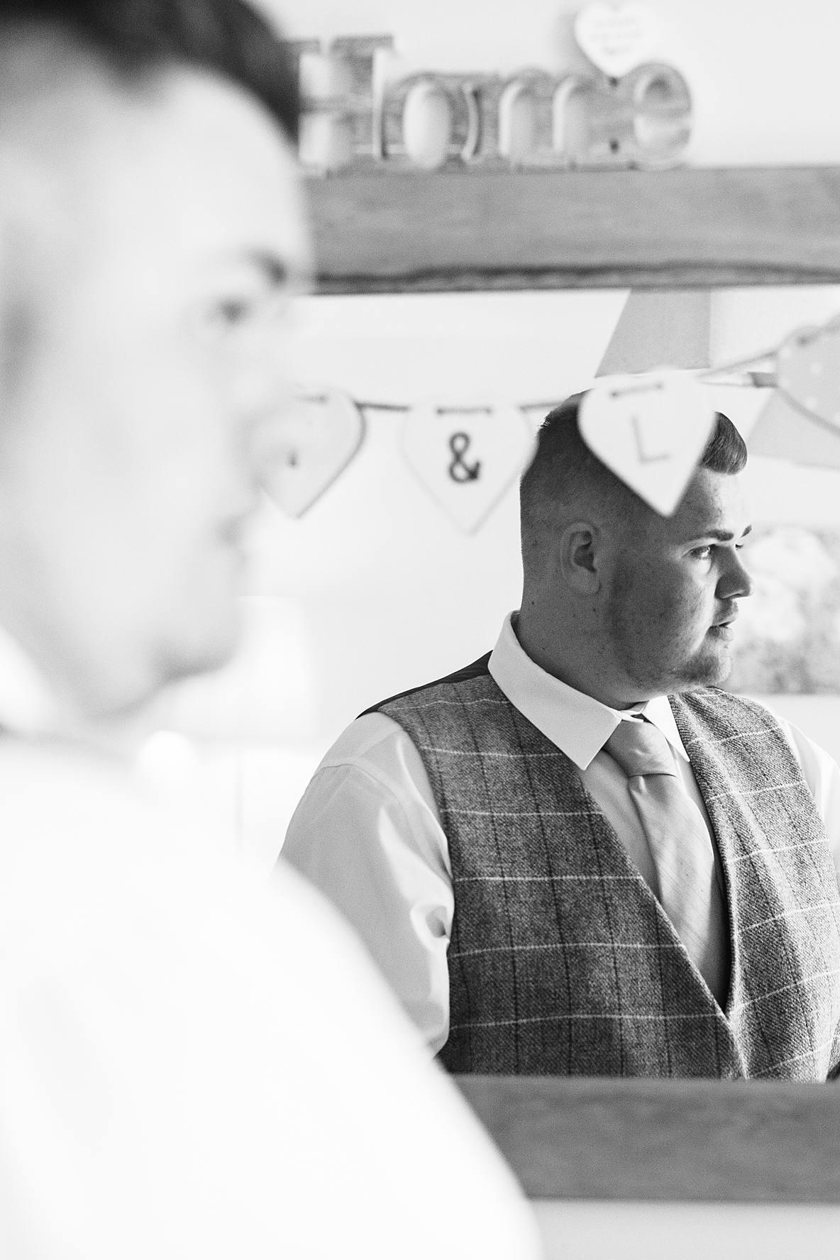 groom black and white mirror Kingscote Barn