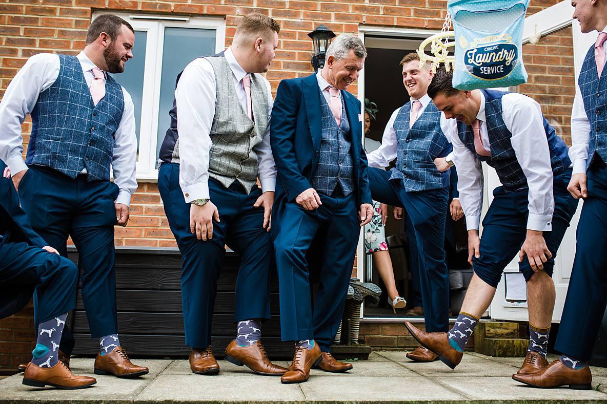 groomsmen with funny socks Kingscote Barn