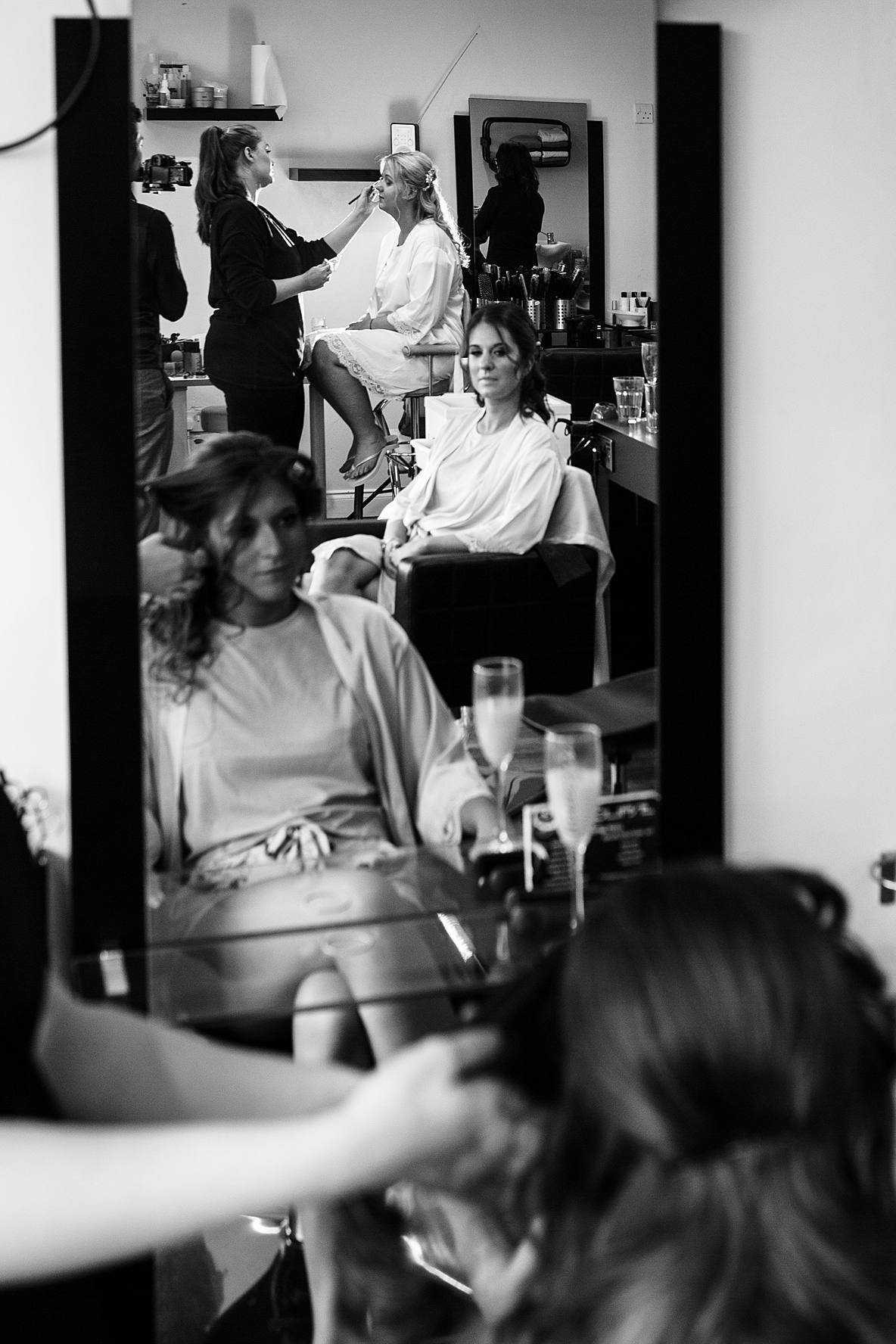 hairdresser with bridal party wedding