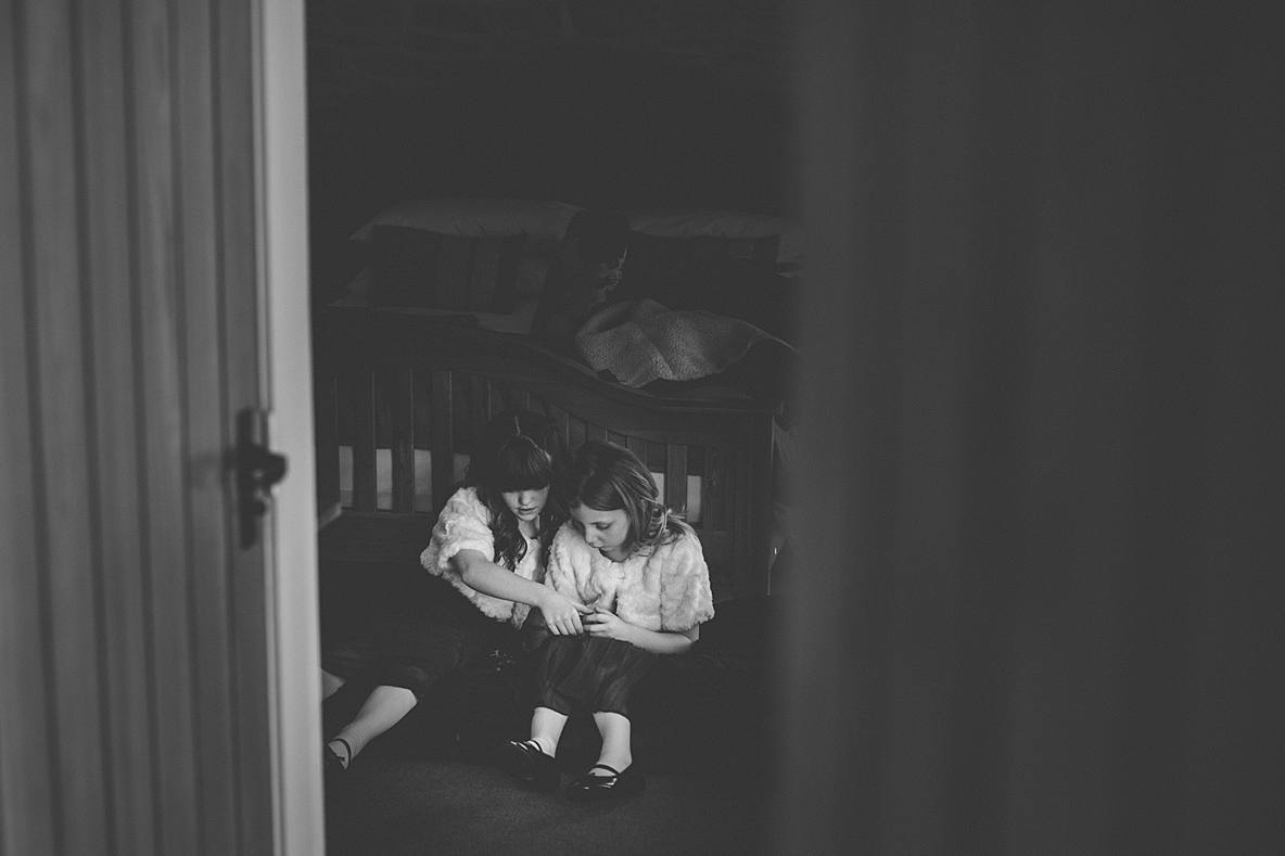 little girls playing game on floor Kingscote Barn
