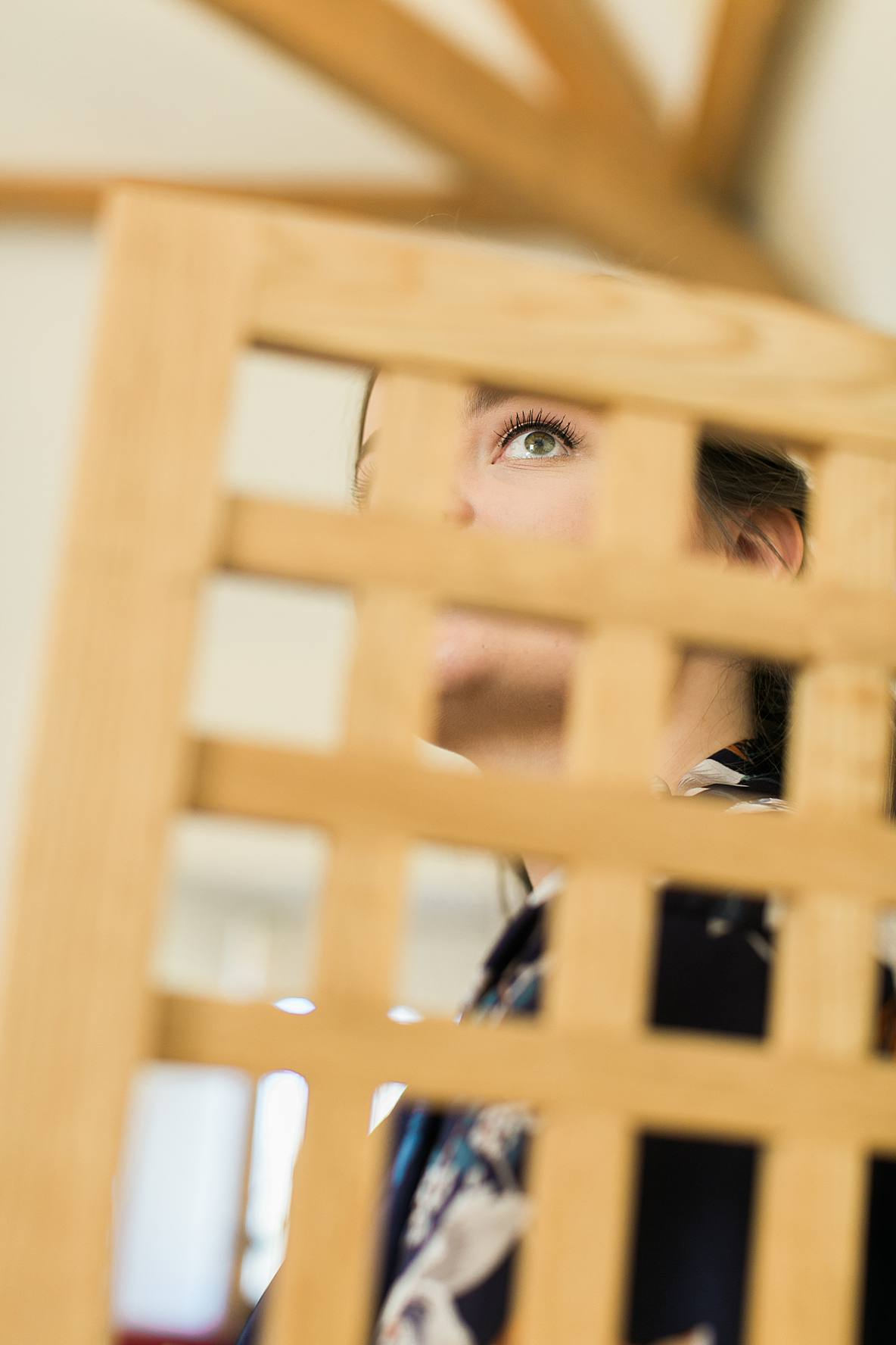 bride looking through chair Kingscote Barn prep photography