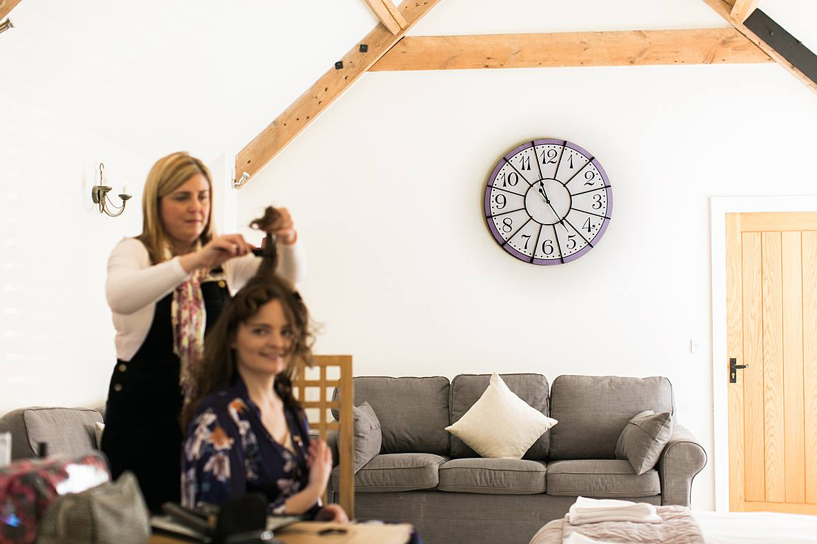 bridal prep Kingscote Barn clock on wall