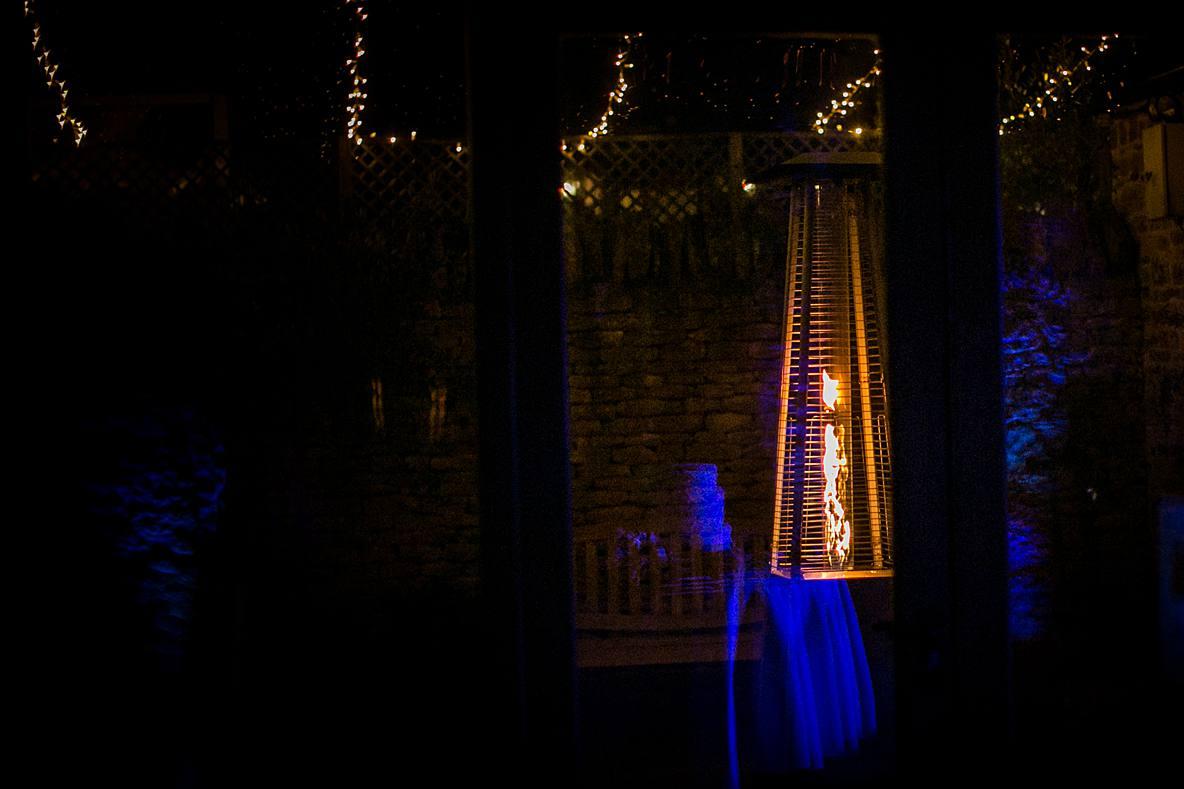 cake reflection in window Kingscote Barn Tetbury wedding photographer