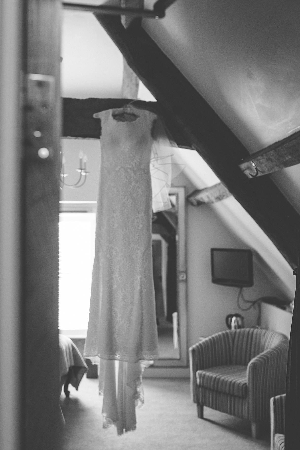 wedding dress hanging bridal suite Kingscote Barn winter wedding