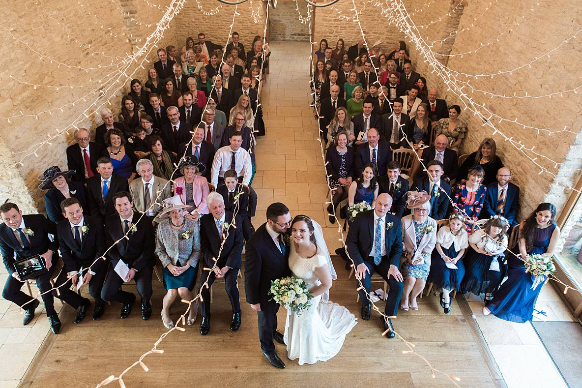 couple with guests formal picture Kingscote Barn January wedding