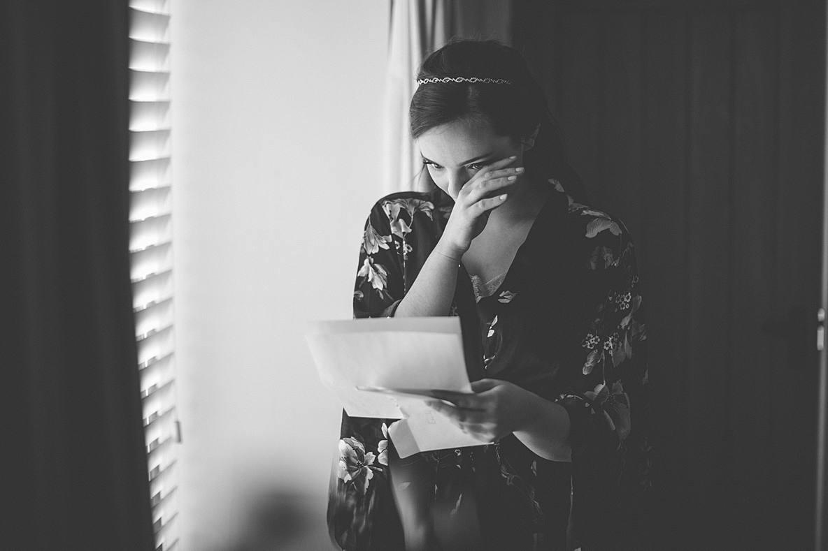 bride reading letter Kingscote Barn photographer
