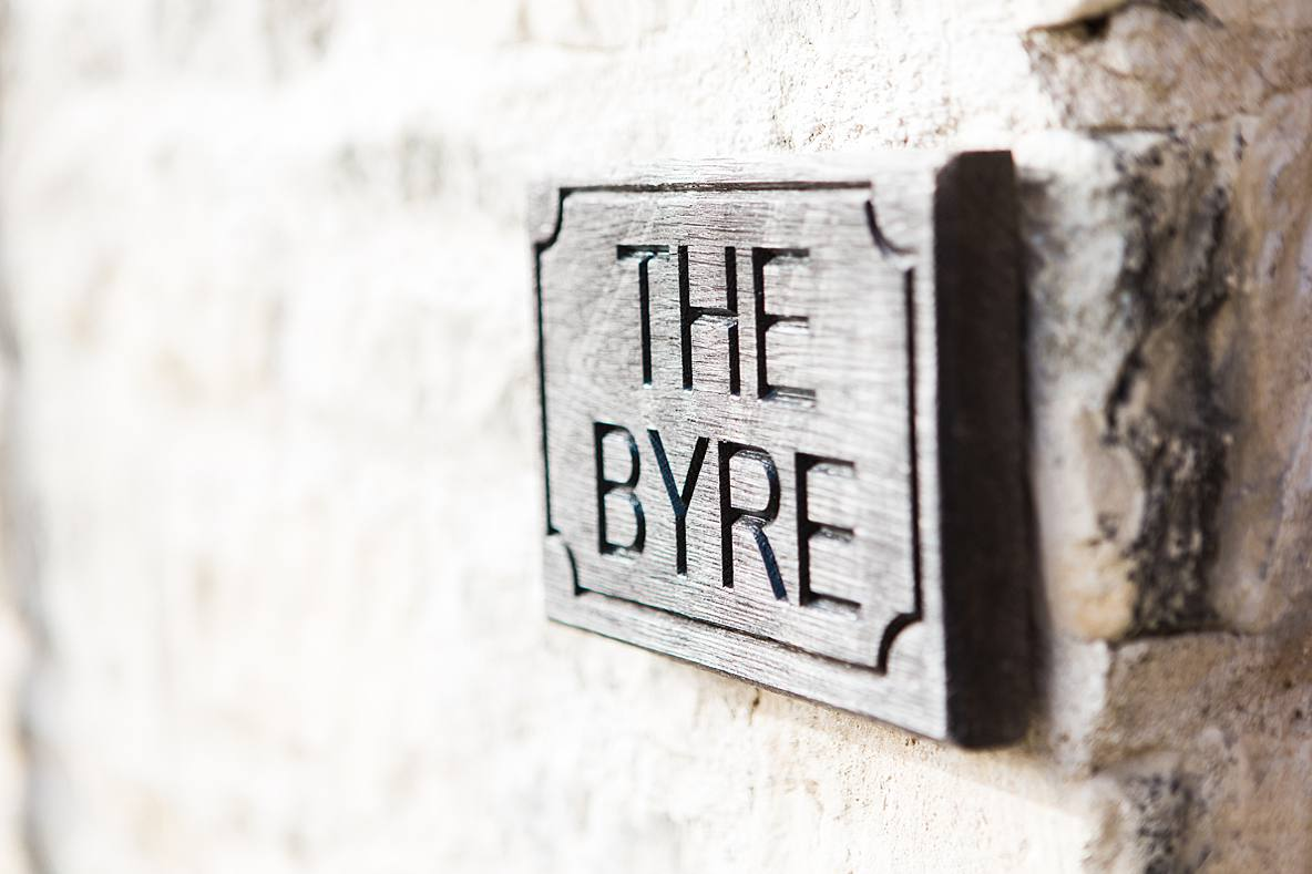 the byre sign Kingscote Barn wedding photographer