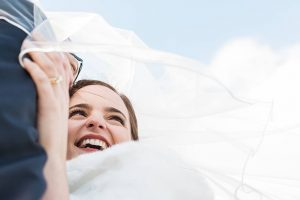 bride laughing winter wedding Kingscote Barn photographer
