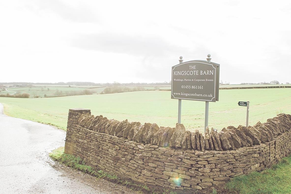 Kingscote Barn sign on road wedding photographer