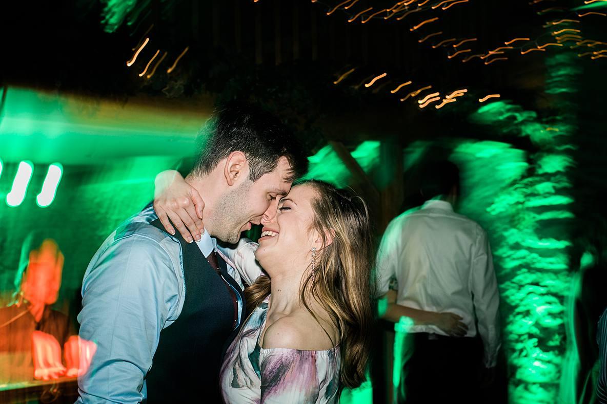 couple dancing at Kingscote Barn winter wedding January