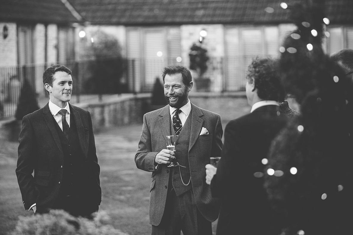 guests standing outside Kingscote Barn wedding photographer