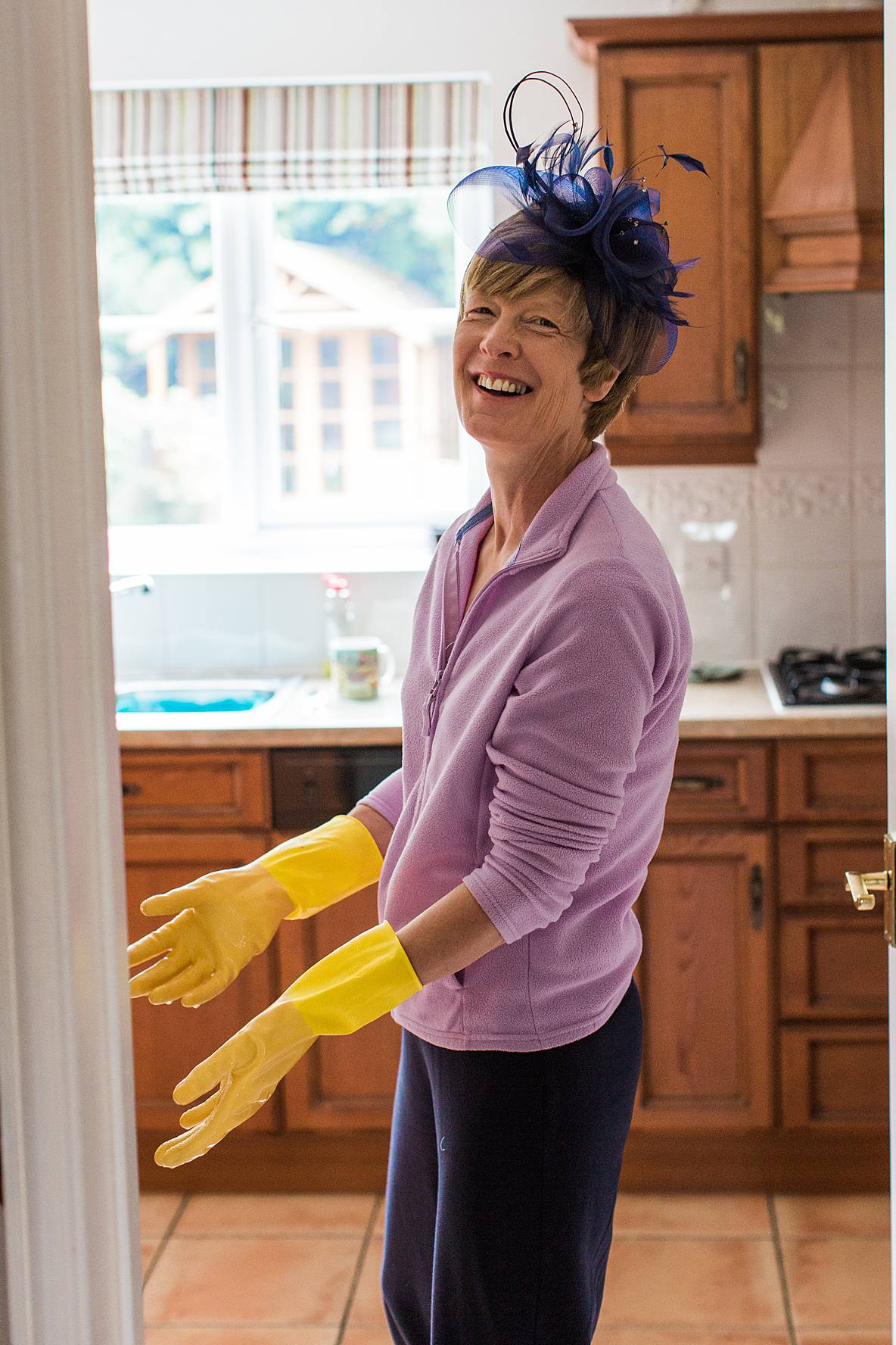 mum wearing rubber gloves on Hereford wedding day
