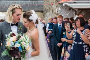 Somerset couple walking through confetti on wedding day