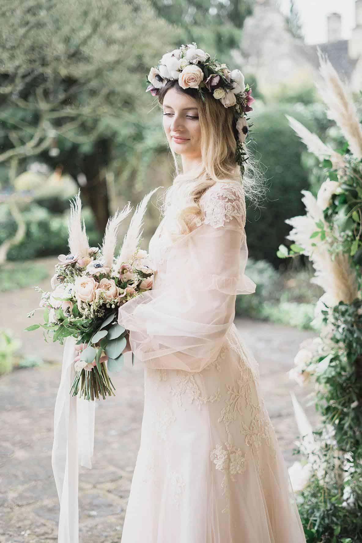 bride in peach wedding dress at Barnsley House for wedding photographer