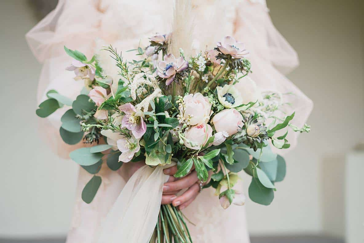 romantic bridal bouquet with roses at Barnsley House cotswolds wedding venue