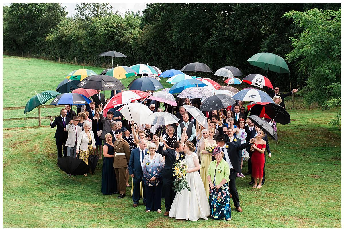 umbrealla heart kiss gloucestershire wedding photography
