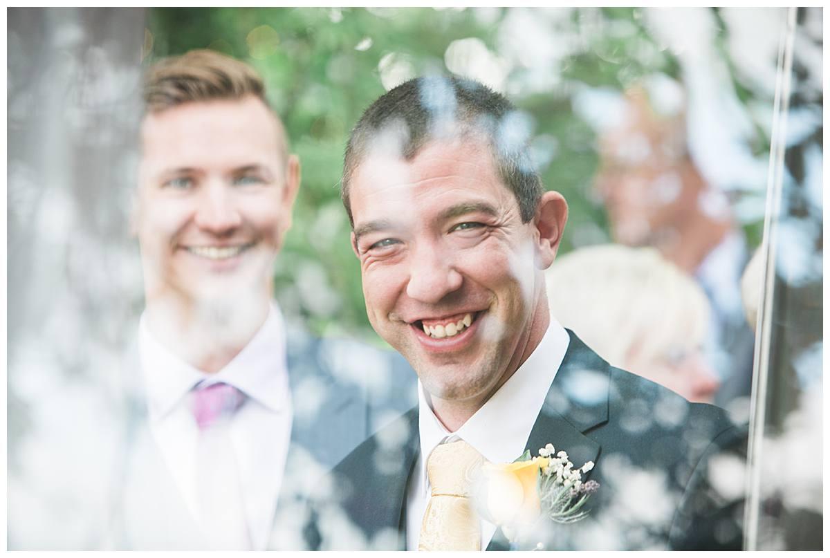 smiling groom gloucestershire wedding photography
