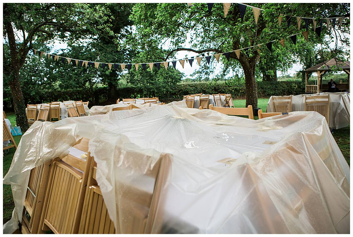 rain covered chairs gloucestershire wedding photography