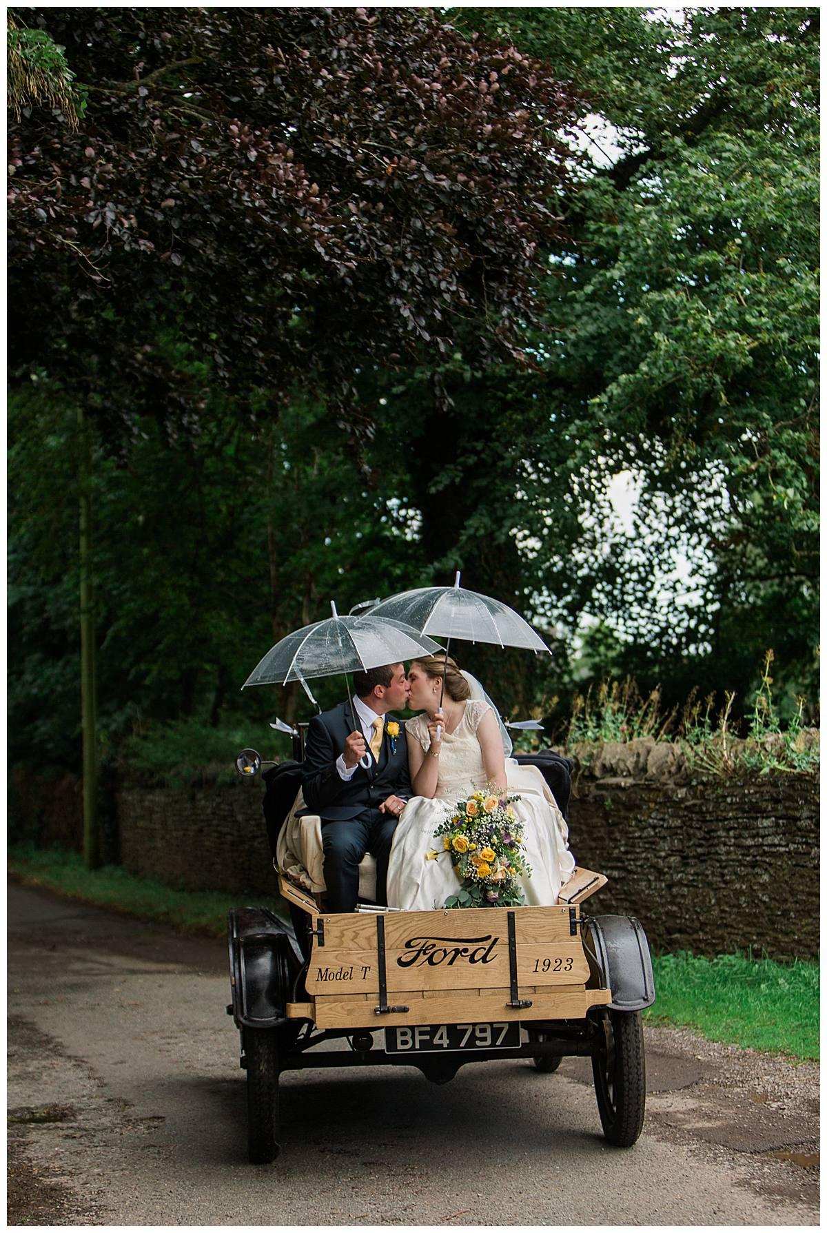 couple kissing gloucestershire wedding photography