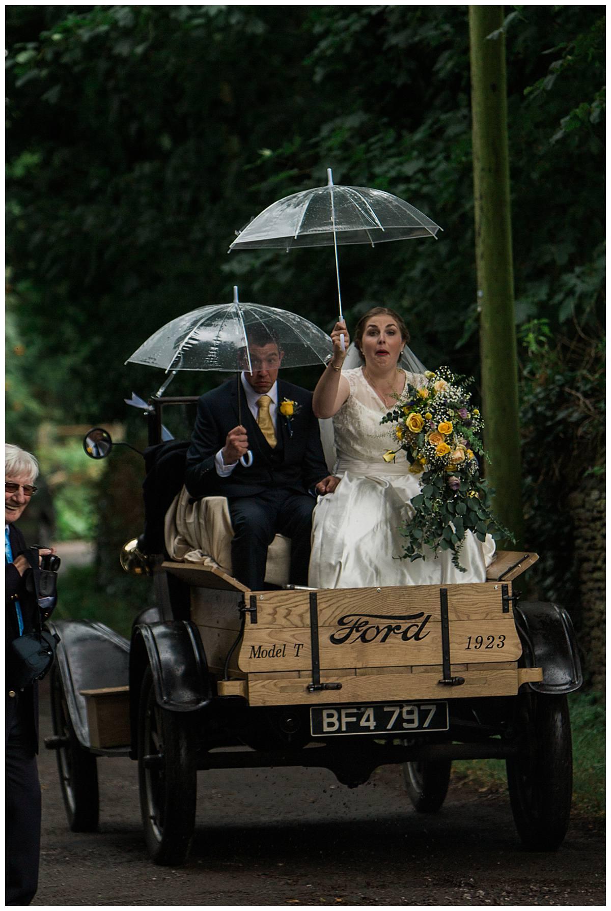 couple with umbrellas gloucestershire wedding photography