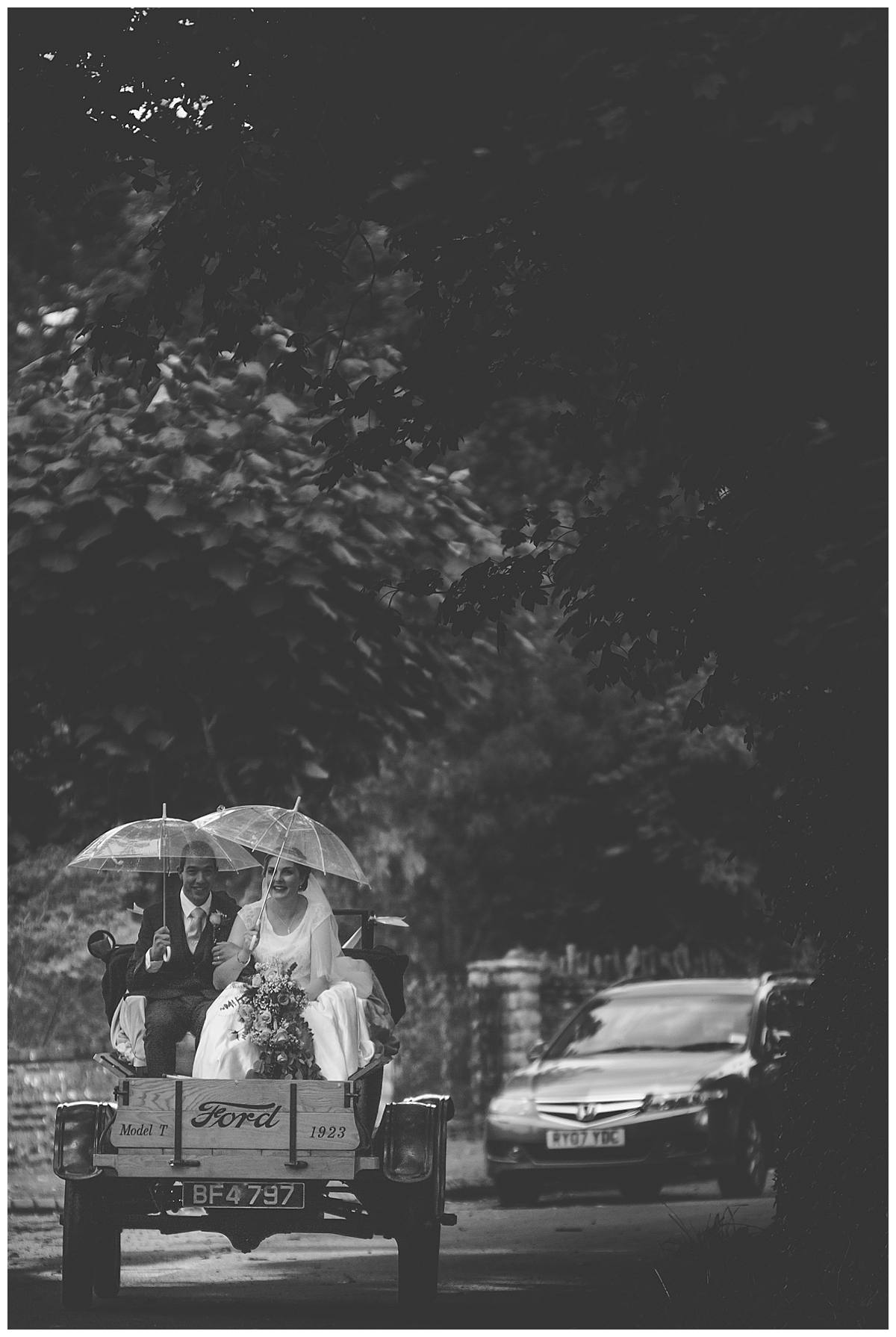 couple in truck gloucestershire wedding photography