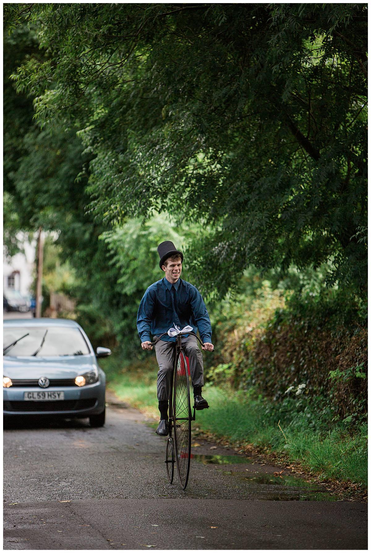 man on bike rustic gloucestershire wedding photography