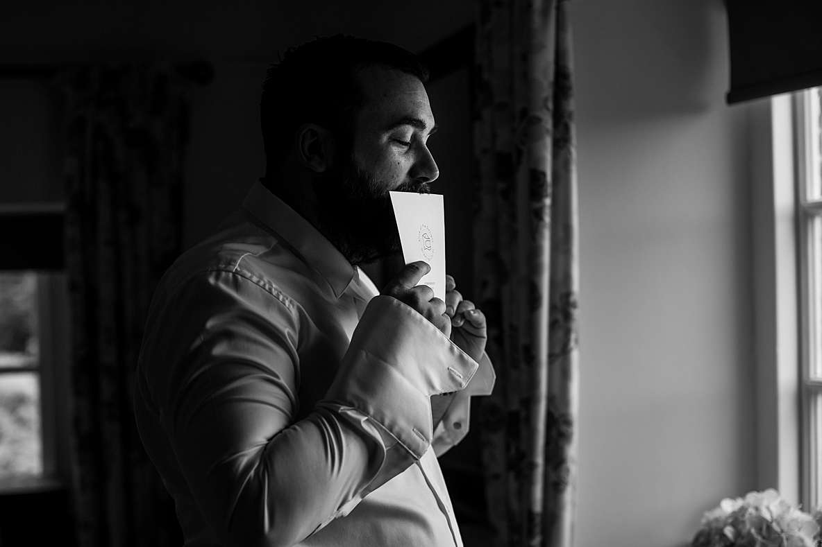 groom kissing card photographers gloucestershire