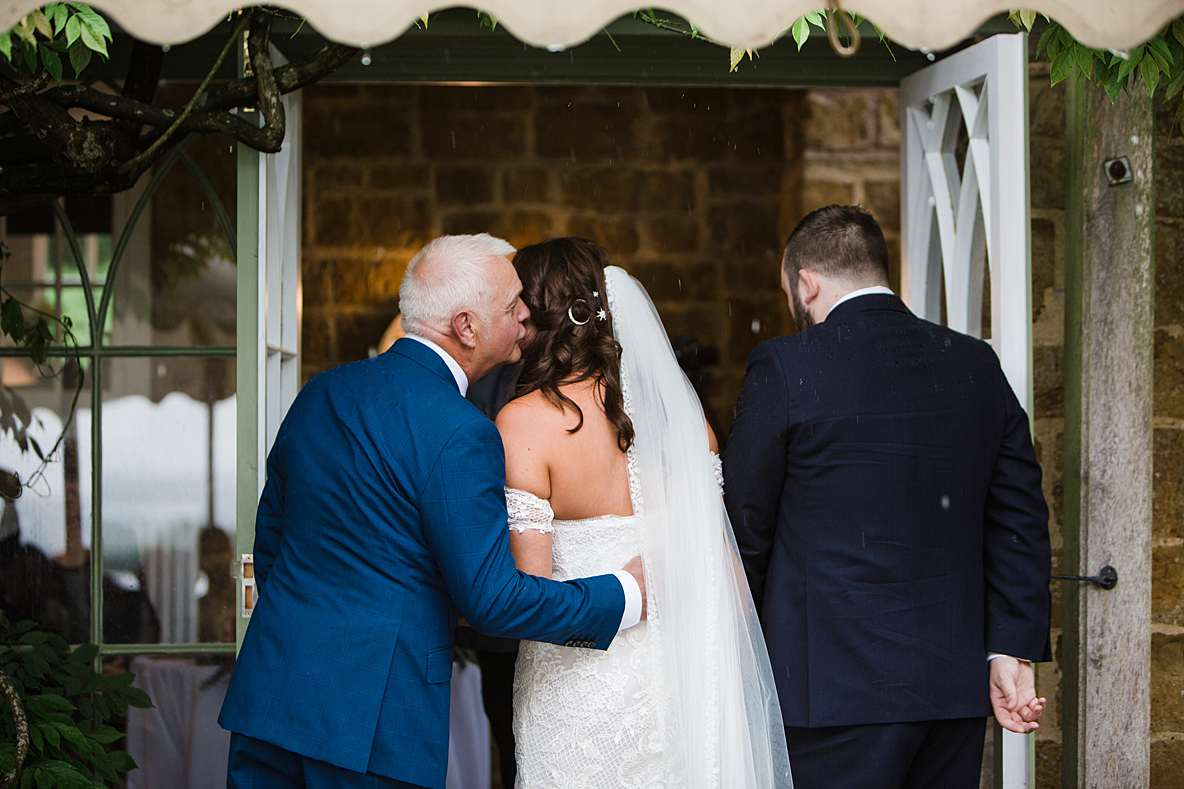 outdoor ceremony rain wedding photographer cheltenham