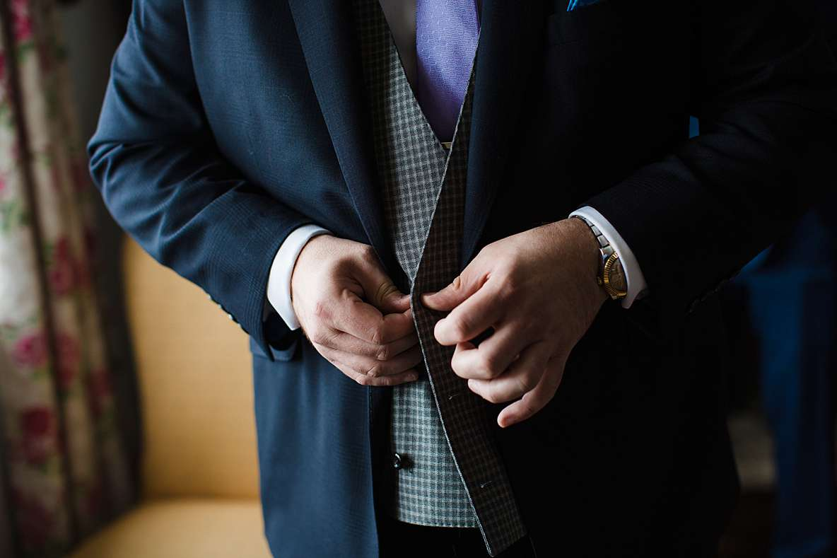 buttoning up coat gloucester wedding photography