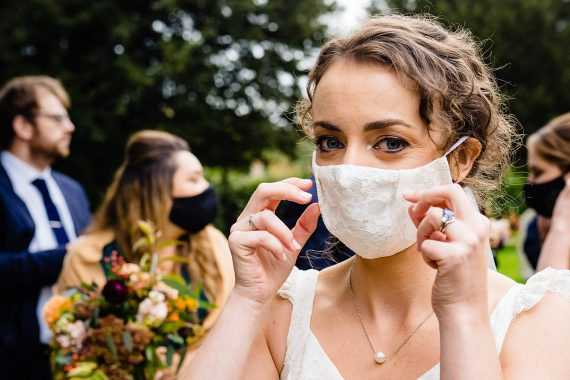 bride with facemask micro wedding photographer gloucestershire