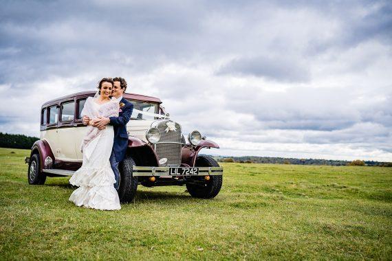 couple with car micro wedding photographer gloucestershire