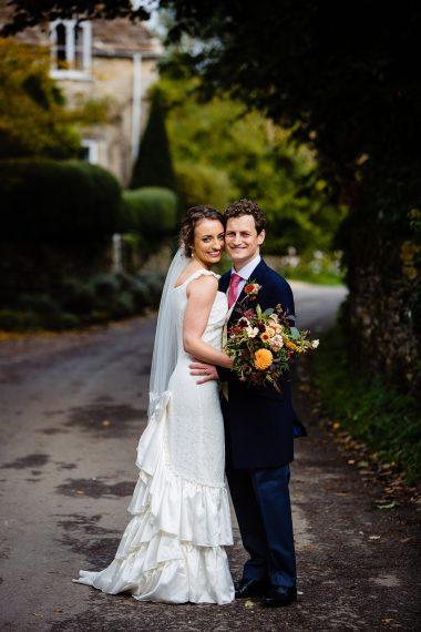 couple hugging micro wedding photographer gloucestershire