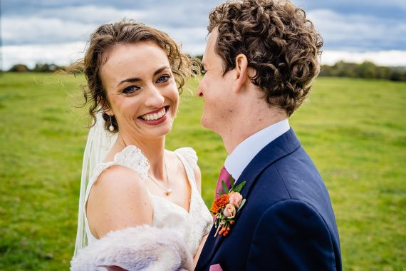 bride smiling micro wedding photographer gloucestershire