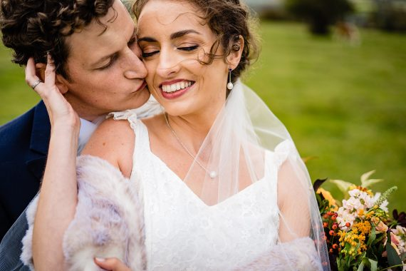 couple with cows micro wedding photographer gloucestershire