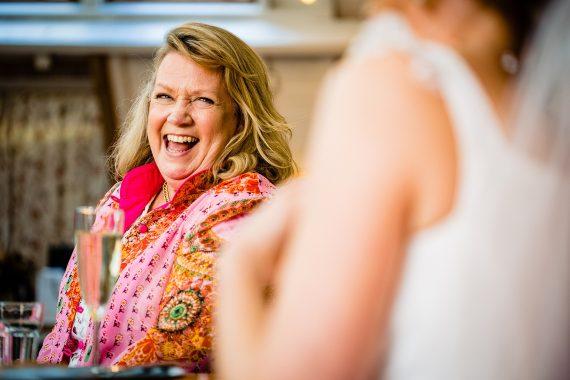 mum laughing micro wedding photographer gloucestershire