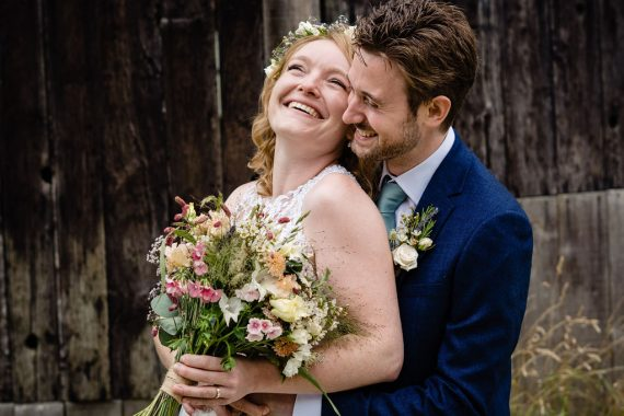 covid micro wedding photographer couple laughing 1