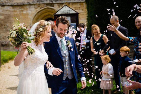 micro wedding photographer throwing confetti bath