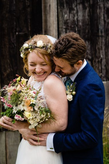 couple squeezing and laughing micro wedding photographer