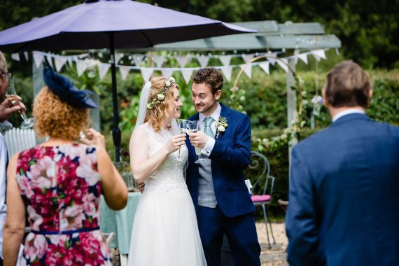 couple cheering with champagne micro wedding photographer