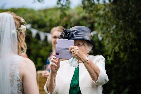 micro wedding photographer grandma with camera