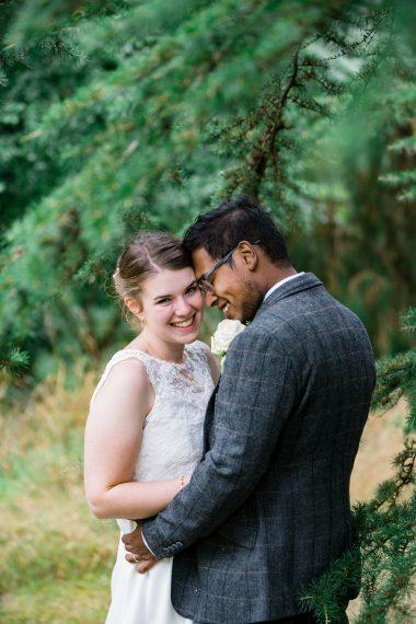micro wedding photographer couple hugging